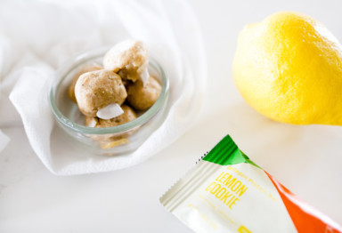 A bag of snacks with a lemon and snack bar
