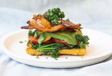 A low-carb spin on an old classic: This keto BLT sandwich layers silky avocado and crispy bacon on chewy, butter-fried coconut bread.