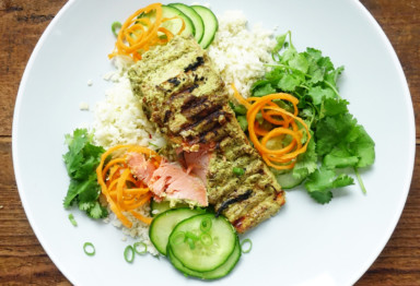 This creamy spiced tandoori salmon recipe with cauliflower rice comes together in minutes for a simple paleo, keto, and Whole30 weeknight dinner.