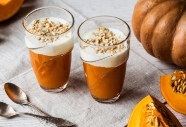 Two pumpkin smoothies topped with oats