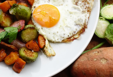 Paleo sweet potato hash gets savory upgrades from crisp bacon and fragrant herbs, all cooked in nourishing fats to keep you full and powered up.