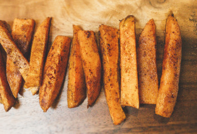 Paleo-friendly pumpkin spice sweet potato fries are a savory take on classic fall flavors -- especially paired with a rich chocolate dipping sauce.