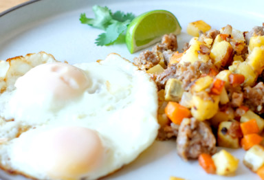 A breakfast plate of eggs and hash