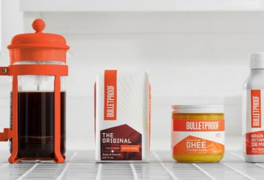 Bulletproof Coffee ingredients next to French press
