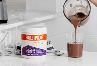 Bulletproof Chocolate Collagen Protein next to smoothie