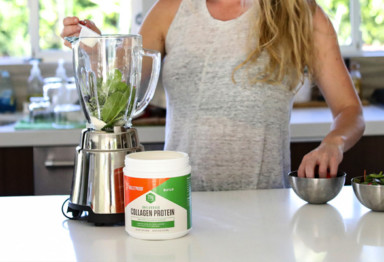 Woman making smoothie with Collagen Protein