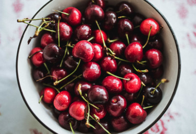Bowl of cherries on tablecloth