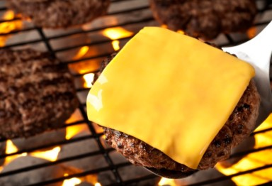 A cheeseburger on the grill