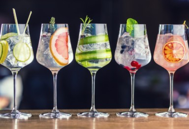 A collection of different cocktails on a bartop