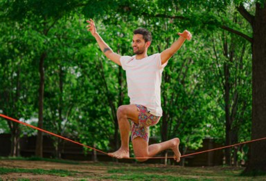 A man on a slackline in the park